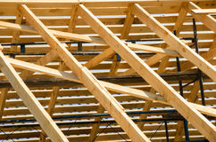 Wooden roof construction. Building in progress. House constructi Royalty Free Stock Photo