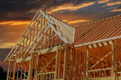 Wooden roof construction, symbolic for home, Stock Photo