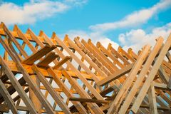 Wooden roof construction, symbolic photo for home, home construction, and home financing.  stock photo