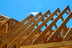 Wooden roof construction, symbolic photo for home, house building. And house financing Stock Image