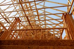Wooden roof construction, symbolic for home, Royalty Free Stock Photo