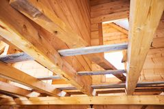 Wooden roof construction symbolic photo for home house building. And house financing royalty free stock photography