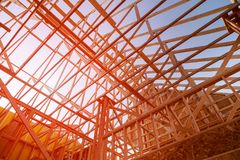 Wooden roof construction, symbolic photo for home, house building. Building new home construction stock image