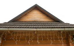 Wooden roof in a country house. Decorated with garlands Stock Photography