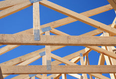 Wooden Roof Frame House Construction. Close up on wooden beam and rafters. Wooden Roof Frame House Construction stock photo