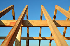 Wooden Roof frame rafters. Against a blue sky stock photos
