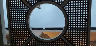 Wooden roof guarding from sun with round hole in the middle stock images