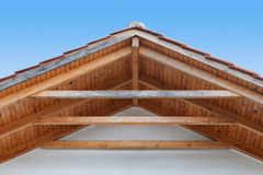 Wooden roof with rafters. Detail of a wooden roof with rafter style framing royalty free stock images