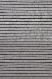 Wooden roof shingle. Gray background Stock Photos