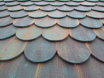 Wooden roof shingles. Roof of wooden planks in the form of shingles royalty free stock photo