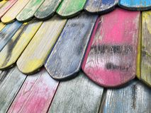Wooden roof tiles closeup of colorful playground house roof royalty free stock photos