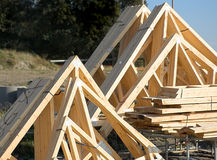 Wooden Roof Trusses. Stacked together on a building site stock image