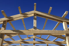 Wooden roof during under construction. Wooden roof during the early stages of construction in a sunny day royalty free stock photo