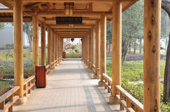 Wooden roofed corridor Stock Images