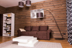 Wooden room interior with couch and table Royalty Free Stock Photo
