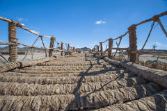 Wooden rope bridge in remote desert Royalty Free Stock Photo