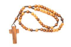 Wooden rosary. Isolated over white Stock Photos