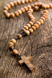 Wooden rosary beads. On old wooden background royalty free stock images
