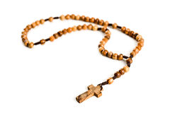 Wooden rosary beads. On white background stock photo
