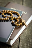 Wooden rosary beads with computer tablet Royalty Free Stock Images