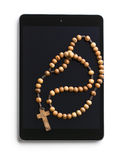 Wooden rosary beads with computer tablet Royalty Free Stock Photo