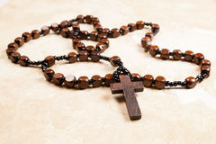 Rosary Beads. Wooden rosary beads and cross Royalty Free Stock Image
