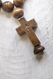 Wooden rosary beads and cross Royalty Free Stock Photo