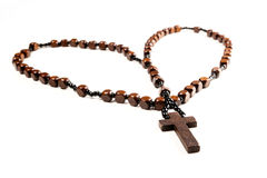 Rosary Beads. Wooden rosary beads and cross isolated on a white background Stock Photo