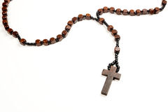 Rosary Beads. Wooden rosary beads and cross isolated on a white background Royalty Free Stock Photography