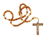 Wooden rosary beads and cross isolated on a white Royalty Free Stock Images