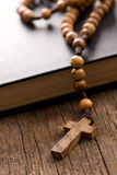 Wooden rosary beads and holy bible Stock Photo
