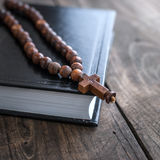 Wooden rosary beads and holy bible Royalty Free Stock Photo