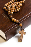 Wooden rosary on the Bible Stock Photography