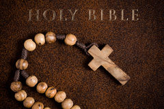 Wooden rosary on the Bible Stock Photo