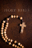 Wooden rosary on the Bible Stock Image