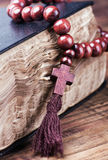 Wooden rosary on the Bible Royalty Free Stock Photos
