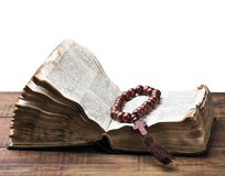 Wooden rosary and the Bible Royalty Free Stock Image