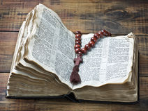 Wooden rosary and the Bible Royalty Free Stock Photos
