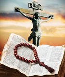 Wooden rosary on the Bible Stock Images