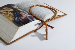 Wooden rosary on a Bible Stock Photo