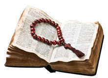 Wooden rosary on the Bible isolated Royalty Free Stock Image