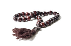 Wooden rosary with a cross Royalty Free Stock Photography