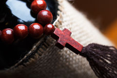 Wooden rosary with a cross Stock Image