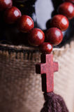 Wooden rosary with cross Royalty Free Stock Photography
