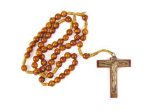 Wooden rosary with cross isolated on a white Stock Image