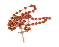 Wooden rosary with a cross on white background Stock Images