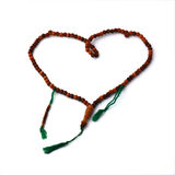 Wooden rosary in heart shape isolated Royalty Free Stock Photo