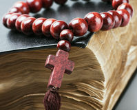 Wooden Rosary On The Bible Are Royalty Free Stock Image