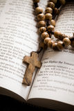 Wooden rosary on the open Bible Royalty Free Stock Image