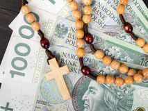Wooden rosary on Polish banknotes Stock Photo